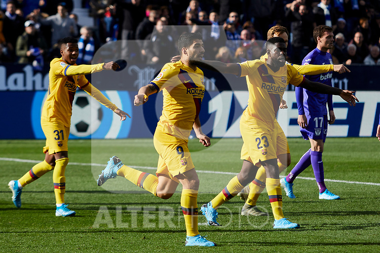 Luis Suarez (L) and Samuel Umtiti (R) of FC Barcelona celebrate goal during La Liga match between CD Leganes and FC Barcelona at Butarque Stadium in Leganes, Spain. November 23, 2019. (ALTERPHOTOS/A. Perez Meca)