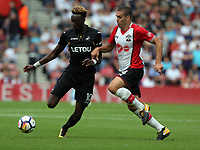 (L-R) Tammy Abraham of Swansea City challenged by Oriol Romeu of Southampton during the Premier League match between Southampton and Swansea City at the St Mary's Stadium, Southampton, England, UK. Saturday 12 August 2017