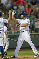 Round Rock Express outfielder Brad Snyder #25 is greeted at home after blasting a home run in the Pacific Coast League baseball game against the Memphis Redbirds on April 24, 2014 at the Dell Diamond in Round Rock, Texas. The Express defeated the Redbirds 6-2. (Andrew Woolley/Four Seam Images)