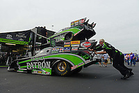 Sept. 30, 2012; Madison, IL, USA: NHRA crew members for funny car driver Alexis DeJoria push her backup car into the pits during the Midwest Nationals at Gateway Motorsports Park. Mandatory Credit: Mark J. Rebilas-