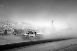 A dust storm envelopes trucks on the roadside on the outskirts of Kabul. Many local people are hoping the winds of change will be blowing through the war torn and poverty stricken country. With only the second ever Presidential elections happening in Afghanistan on Thursday August 20 life in the capital of Kabul has taken on a high level of tension. Insurgent attacks on an almost daily basis including rocket attacks and suicide bombers, have everyone on a knife edge. Security measures have become drastic and it especially unsafe to be in large crowds - where the attackers often aim. Despite the massive security presence life still goes on in the capital and the population lives in hope that the next government will provide security, peace and a way forward from the harsh poverty endured by most of the population of this war torn country.