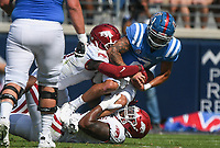 Arkansas wide receiver Trey Knox (7) and defensive lineman Eric Gregory (50) tackle Ole Miss quarterback Matt Corral (2), Saturday, October 9, 2021 during the first quarter of a football game at Vaught Hemingway Stadium in Oxford, Miss. Check out nwaonline.com/211010Daily/ for today's photo gallery. <br /> (NWA Democrat-Gazette/Charlie Kaijo)