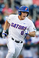 Florida Gators outfielder Harrison Bader (8) runs to first base against the Miami Hurricanes in the NCAA College World Series on June 13, 2015 at TD Ameritrade Park in Omaha, Nebraska. Florida defeated Miami 15-3. (Andrew Woolley/Four Seam Images)