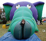 Luke Martin,5, emerges from one of the attractions at the Lanier Law Firm's Holiday Bash Sunday Dec. 13,2009.(Dave Rossman/For the Chronicle)