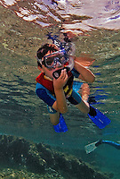 16 August 2005: Snorkeler Joshua holds the mouthpiece of his snorkel as he observes the marine life at Captain Don's Reef off the coast of Bonaire, in the Netherland Antilles. Housing used was an Aquatica D100 with 8 inch dome port. Lighting with twin Ikelite 225s strobes, manual at 1/4 power setting...Mandatory Photo Credit: Ed Wolfstein Photo