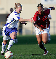Ferreiras, PORTUGAL: Finland player (L) vies with Natasha Kai (R) at the Nora Stadium in Ferreiras, March 09 of 2007, during the Algarve Women´s Cup soccer match between USA and Finland. USA won 1-0. Paulo Cordeiro/International Sports Image