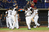 Quad Cities River Bandits Dexture McCall (27) and Hector Roa (15)  celebrate with Randy Cesar (39) after a walk off base hit during a game against the Bowling Green Hot Rods on July 24, 2016 at Modern Woodmen Park in Davenport, Iowa.  Quad Cities defeated Bowling Green 6-5.  (Mike Janes/Four Seam Images)