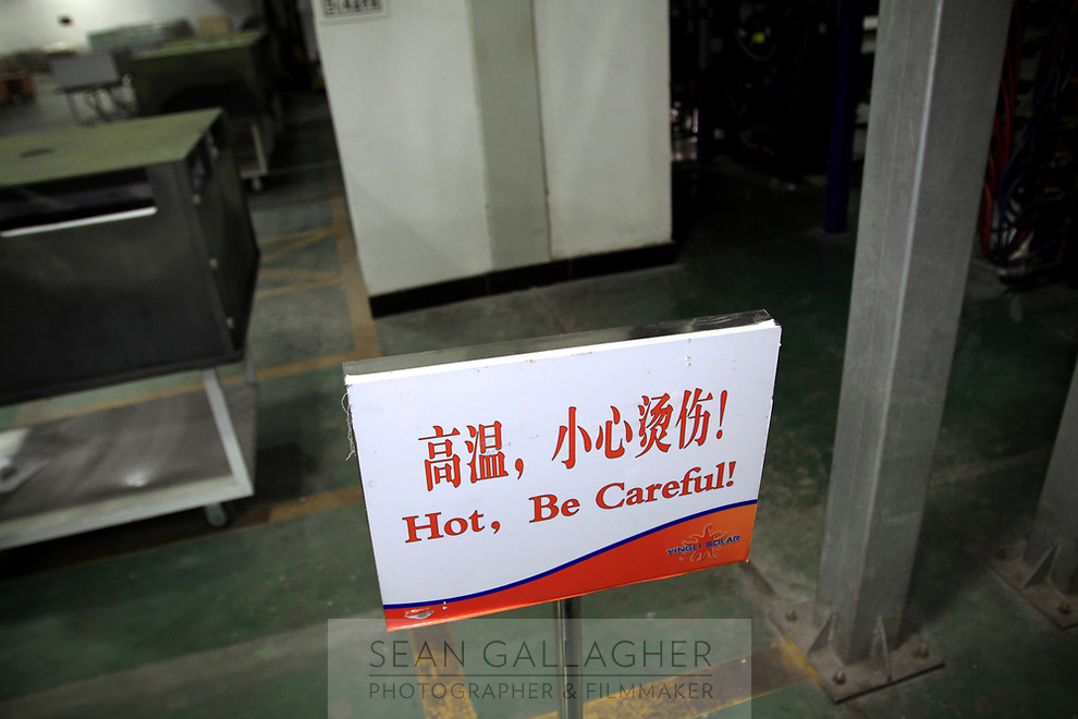 CHINA. Hebei.  Inside a factory producing solar panals in Baoding City near Beijing, the world's first 'carbon positive' town. The town's main industires focus on producing wind and solar technologies. 2009