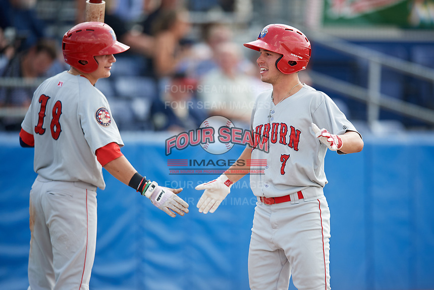 Auburn Doubledays third baseman Cole Daily (7) is congratulated by Jacob Rhinesmith (18) as he returns to the dugout after hitting a home run in the top of the ninth inning during a game against the Batavia Muckdogs on September 1, 2018 at Dwyer Stadium in Batavia, New York.  Auburn defeated Batavia 10-5.  (Mike Janes/Four Seam Images)