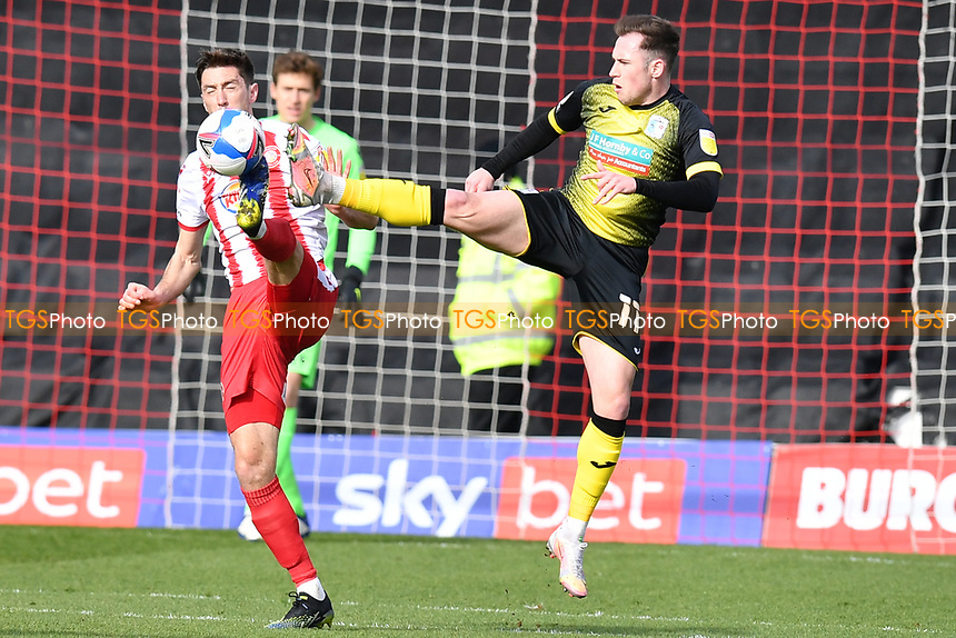Josh Kay of Barrow AFC and Luke Prosser of Stevenage FC during Stevenage vs Barrow, Sky Bet EFL League 2 Football at the Lamex Stadium on 27th March 2021