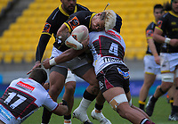 Alex Fidow is tackled during the Mitre 10 Cup rugby match between Wellington Lions and North Harbour at Sky Stadium in Wellington, New Zealand on Saturday, 17 October 2020. Photo: Dave Lintott / lintottphoto.co.nz