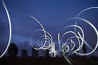 Callanish standing stones at night illuminated by lights, Isle of Lewis, Outer Hebrides, Scotland