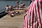 Henley Royal Regatta, Henley on Thames, Oxfordshire, England. Exhausted rowers throw themselves on the floor after finishing first in their race. Abingdon School.2000s