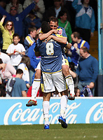 ATTENTION SPORTS PICTURE DESK<br /> Pictured: Michael Chopra of Cardiff City is held by team mate Jay Bothroyd (8) celebrating their team equaliser<br /> Re: Coca Cola Championship, Cardiff City FC v Swansea City FC at Ninian Park, Cardiff, south Wales. Sunday 05 April 2009.<br /> Picture by D Legakis Photography / Athena Picture Agency, Swansea 07815441513