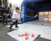 A young fan enjoys the Fan Fest prior to the Frozen Four final on Saturday, April 11, 2015, outside TD Garden in Boston, Massachusetts.