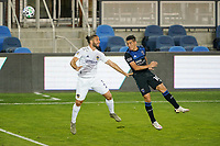 SAN JOSE, CA - OCTOBER 03: Cristian Espinoza #10 of the San Jose Earthquakes goes up for a header with Emiliano Insua #3 of the Los Angeles Galaxy during a game between Los Angeles Galaxy and San Jose Earthquakes at Earthquakes Stadium on October 03, 2020 in San Jose, California.
