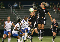 Lori Lindsey #6 of the Washington Freedom flicks the ball towards Maggie Tomecks #5, Candace Chapman #9 and Fabiana #15 of the Boston Breakers during a WPS match at Maryland Soccerplex on July 29, in Boyds, Maryland. Freedom won 1-0.
