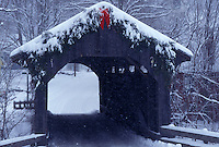 AJ4696, covered bridge, winter scene, Vermont, Christmas decorations on the snow covered Village or Church Street Covered Bridge on a winter day in Waterville in Lamoille County in the state of Vermont.
