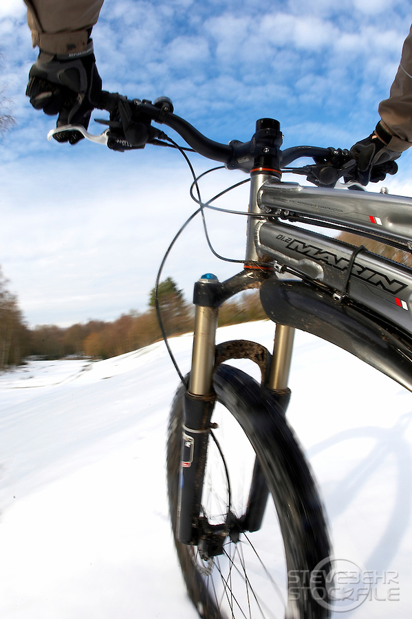on bike camera view of Marin Mountain bike riding in the snow..Virginia Water , Surrey  February 2009..pic copyright Steve Behr / Stockfile