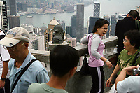 CHINA. Hong Kong. Tourists on Victoria peak overlookig Hong Kong. Officially the Hong Kong Special Administrative Region, it is a territory located on China's south coast on the Pearl River Delta. It has a population of 6.9 million people, and is one of the most densely populated areas in the world. 2008