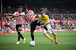 Home players Julian Jeanvier and Ezri Konsa battle for possession with Stauart Dallas during the first-half as Brentford hosted Leeds United in an EFL Championship match at Griffin Park. Formed in 1889, Brentford have played their home games at Griffin Park since 1904, but are moving to a new purpose-built stadium nearby. The home team won this match by 2-0 watched by a crowd of 11,580.