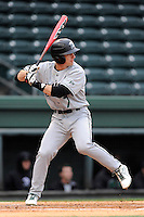 Left fielder Steven Dowling (7) of the USC Upstate Spartans bats in a game against the Furman University Paladins on Tuesday, March 4, 2013, at Fluor Field at the West End in Greenville, South Carolina. Furman won, 13-1. (Tom Priddy/Four Seam Images)