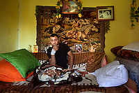 Cristi Radu sits in his bedroom after finding out that his brother, Florea, had been electrocuted in stealing copper from power lines in Spain. Buzescu is known for it's ultra-wealthy Roma and their bizarre mansions that line the main street. The Roma of Buzescu are part of the Kalderash clan and are known for being coppersmiths and dealing with metal scraps. After the fall of the communist regime in the late 80's, they stripped old factories of their metals and some made a small fortune re-selling them. They are also known for making cazane, copper stills that produce alcohol such as palinka, a plum brandy.