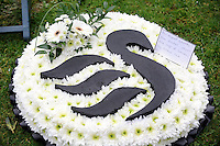 Pictured: Floral tribute from Swansea City Football Club.<br />