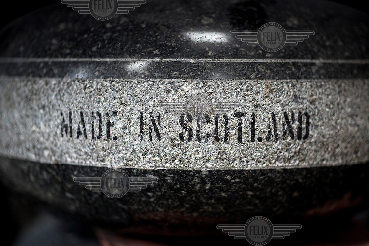 A curling stone, made from Ailsa Craig granite and engraved with a 'Made in Scotland' logo, at Kay's in Mauchline, Faslane. The company uses the same rock to make the stones that will be used at the Sochi Olympic Games.