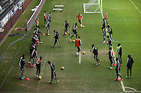 Wednesday 05 February 2014<br /> Pictured: Players warming up<br /> Re: Swansea City FC training with Garry Monk as head coach after the departure of Michael Laudrup, at the Li Liberty Stadium, south Wales.