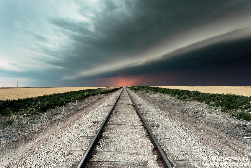 Thunderstorm Shelf Cloud w/ Sunset at the End of Railroad Tracks in Goodland, KS, June 15, 2012