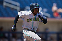 Korey Holland (15) of the Lynchburg Hillcats hustles down the first base line against the Kannapolis Cannon Ballers at Atrium Health Ballpark on August 29, 2021 in Kannapolis, North Carolina. (Brian Westerholt/Four Seam Images)