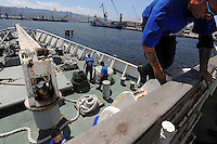 Haifa, Israel:.Trainees participate in a dry drill, during a course teaching to fight maritime terror and piracy, on a boat in Haifa Port..June 11, 2009 (Photo by Ahikam Seri).