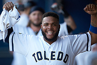 Edwin Espinal (22) of the Toledo Mud Hens flexes his muscles during the game against the Louisville Bats at Fifth Third Field on June 16, 2018 in Toledo, Ohio. The Mud Hens defeated the Bats 7-4.  (Brian Westerholt/Four Seam Images)