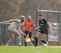 LOUISVILLE, KY - MARCH 13: Cece Kizer #5 of Racing Louisville FC maneuvers the ball during a game between West Virginia University and Racing Louisville FC at Thurman Hutchins Park on March 13, 2021 in Louisville, Kentucky.