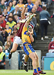 Adrian Tuohey of Galway in action against Podge Collins of Clare during their All-Ireland semi-final at Croke Park. Photograph by John Kelly.