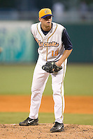 Montgomery Biscuits starting pitcher Mitch Talbot looks into his catcher for the sign in game action versus the Chattanooga Lookouts at Riverwalk Stadium in Montgomery, AL, Friday, August 18, 2006.