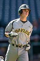 Baylor Bears pinch hitter Justin Arrington (1) runs to first base during Houston College Classic against the Hawaii Rainbow Warriors on March 6, 2015 at Minute Maid Park in Houston, Texas. Hawaii defeated Baylor 2-1. (Andrew Woolley/Four Seam Images)