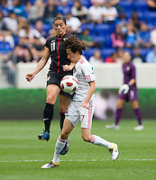 Ali Krieger (11) of the USWNT collides with Tania Morales (17) of Mexico during the game at Red Bull Arena in Harrison, NJ.  The USWNT defeated Mexico, 1-0.