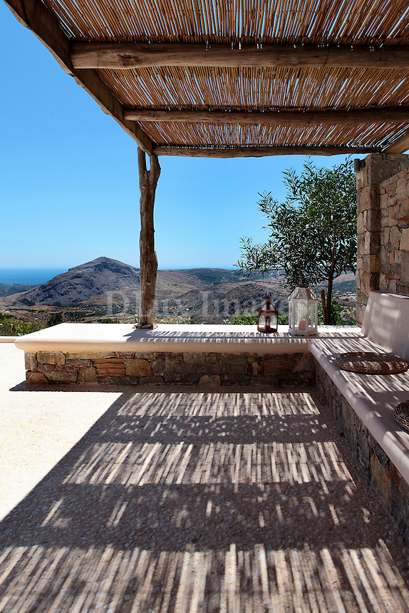 hill view from the patio<br /> <br /> Pavlou Firigos' house, located at the eastern end of Kythira island in Greece, was built to the standards of bioclimatic architecture with respect for the landscape and preserving the local traditional settlement.