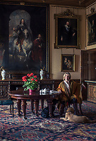 The Countess of Carnarvon and her dogs in an anteroom at Highclere Castle