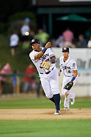 Kane County Cougars third baseman Eudy Ramos (19) throws to first base during a game against the West Michigan Whitecaps on July 19, 2018 at Northwestern Medicine Field in Geneva, Illinois.  Kane County defeated West Michigan 8-5.  (Mike Janes/Four Seam Images)
