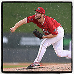 Starting pitcher Durin O'Linger (10) of the Greenville Drive works as a sudden downpour begins during Game 2 of a doubleheader against the Rome Braves on Friday, August 3, 2018, at Fluor Field at the West End in Greenville, South Carolina. Rome won, 6-3. (Tom Priddy/Four Seam Images)