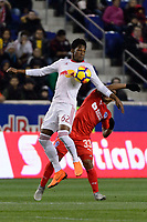 Harrison, NJ - Thursday March 01, 2018: Michael Murillo, Michael Chirinos. The New York Red Bulls defeated C.D. Olimpia 2-0 (3-1 on aggregate) during a 2018 CONCACAF Champions League Round of 16 match at Red Bull Arena.