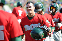 Fort Wayne TinCaps outfielder Alberth Martinez (14) after hitting a home run during a game against the Great Lakes Loons on August 18, 2013 at Dow Diamond in Midland, Michigan.  Fort Wayne defeated Great Lakes 4-3.  (Mike Janes/Four Seam Images)