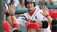 Sept. 3, 2009: Outfielder Kade Keowen (47) of the Greenville Drive is congratulated in the dugout after hitting a home run in a game at Fluor Field at the West End in Greenville, S.C. Photo by Tom Priddy/FourSeam Images