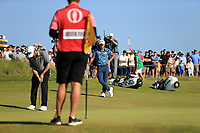 18th July 2021; Royal St Georges Golf Club, Sandwich, Kent, England; The Open Championship Golf, Day Four; Collin Morikawa (USA) looks on as Louis Oosthuizen (RSA) putts on the 16th green to try and reduce the two shot deficit