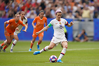 LYON, FRANCE - JULY 07: Megan Rapinoe #15 of the United States takes a penalty kick during the 2019 FIFA Women's World Cup France final match between the Netherlands and the United States at Stade de Lyon on July 07, 2019 in Lyon, France.
