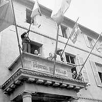 General Charles de Gaulle, President of the French Committee of National Liberation, speaks to the people of Cherbourg from the balcony of the City Hall during his visit to the French port city on August 20, 1944.  (OWI)
