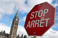 A French-English bilingual stop (arret) sign is see by the Canadian Parliament in Ottawa Saturday September 25, 2010.<br /> <br /> PHOTO :  Francis Vachon - Agence Quebec Presse
